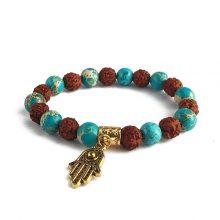 دستبند سنگی رودراکشا و سنگ فیروزه حلقه طلایی طرح : دست همسا